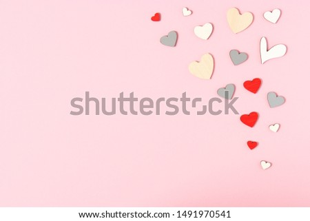 Hearts on a colored background top view. Background for Valentine's Day. Romantic background.