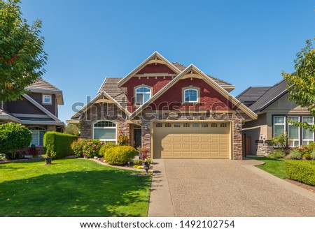 A perfect neighbourhood. Houses in suburb at Summer in the north America. Luxury houses with nice landscape. #1492102754