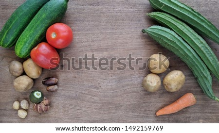 Vegetable variations on wood texture. Harvest vegetables concept background with copy space for text #1492159769