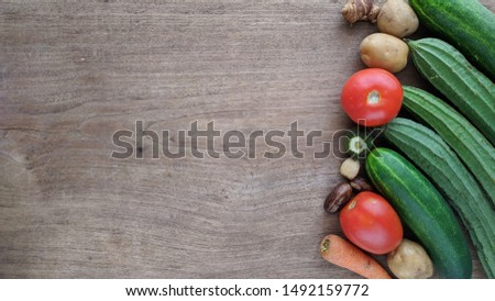 Vegetable variations on wood texture. Harvest vegetables concept background with copy space for text #1492159772