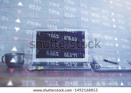 Stock market graph on background with desk and personal computer. Double exposure. Concept of financial analysis. #1492168853