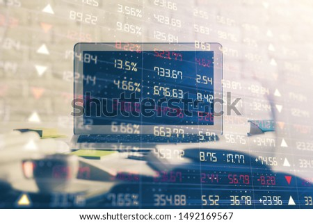 Forex market chart hologram and personal computer background. Double exposure. Concept of investment. #1492169567