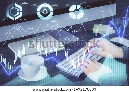 Multi exposure of graph with man typing on computer in office on background. Concept of hard work. #1492170833