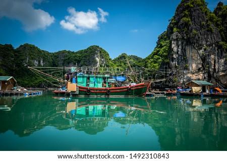 Big fishing boat at Vung Vieng floating village in Halong Bay / bai tu long bay, Vietnam. Royalty-Free Stock Photo #1492310843