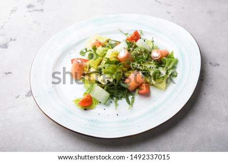 Salmon and white cheese mixed vegetable salad served with arugula #1492337015