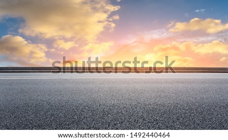 Empty asphalt highway and beautiful sky clouds at sunset #1492440464