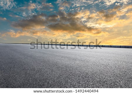 Empty asphalt highway and beautiful sky clouds at sunset #1492440494