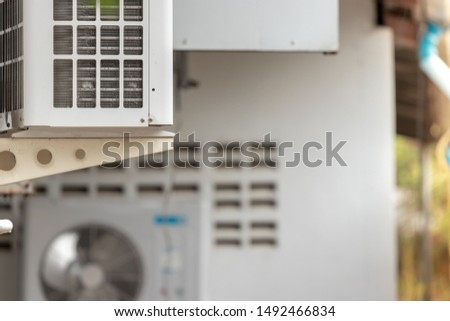 White air conditioner outside the building #1492466834