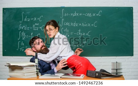 Sex education. Resist temptation. Initiative girl. Harassment at work. Seductive girl cuddle man. Sexual temptation at workplace. Teacher student flirting. Sexual provocation. Provoke sexual desire. #1492467236
