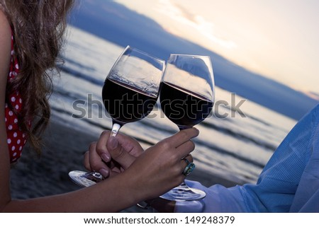 Two glasses of wine on the beach background, sunset, love #149248379
