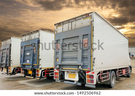 back a trucks with hydraulic lift parking at warehouse, freight industry logistics and transport #1492506962