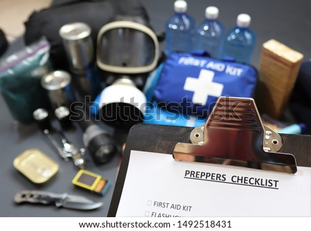 Clipboard checklist.Preppers are know for preparing for natural disasters,economic collapse,civil unrest or any doomsday scenario Such items would include food,water,lighting,shelter,and first aid kit #1492518431