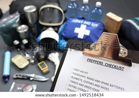 Clipboard checklist.Preppers are know for preparing for natural disasters,economic collapse,civil unrest or any doomsday scenario Such items would include food,water,lighting,shelter,and first aid kit #1492518434
