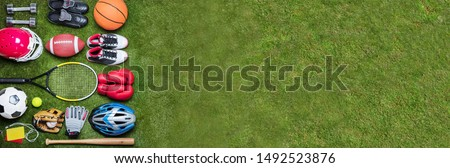 High Angle View Of Various Sport Equipment's On Green Grass #1492523876