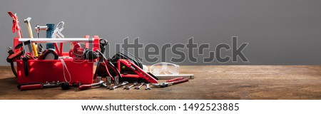 Toolbox With Various Work Tools On Wooden Desk #1492523885