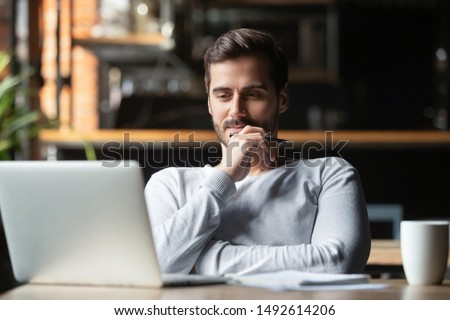 Thoughtful businessman think of online project looking at laptop at workplace, dreamy professional consider solution sit at work desk with computer, student search new idea inspiration in office cafe #1492614206