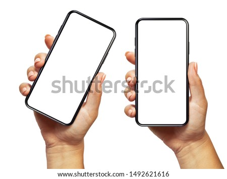 Woman hand holding the black smartphone with blank screen and modern frameless design two positions angled and vertical - isolated on white background Royalty-Free Stock Photo #1492621616