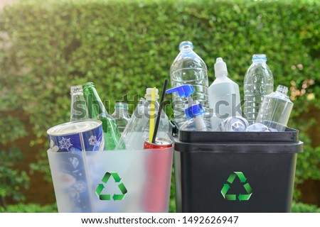 Close up plastic and  glass bottle in the bins for separating recycle materials from the garbages. Reducing waste by following the green concept. Recycling process. Royalty-Free Stock Photo #1492626947
