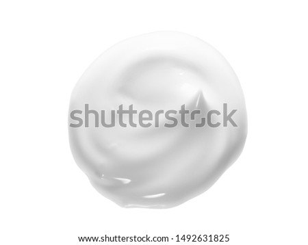 White face cream swirl swatch isolated. Body lotion drop. Cosmetic makeup product sample on white background. BB, CC cream texture #1492631825