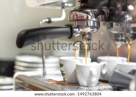 Espresso pouring from espresso coffee machine. Hot beverages. Two espresso pouring from espresso coffee machine. Hot beverages, coffee preparation and barista . #1492763804