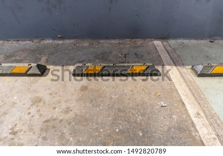 Prefabricated rubber buffers for wheels and boundaries in a vehicle parking lot. #1492820789