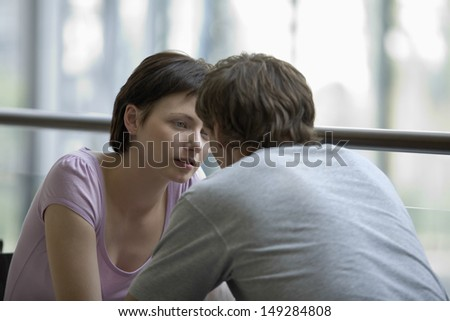 Young woman with man sitting in cafe of shopping center #149284808