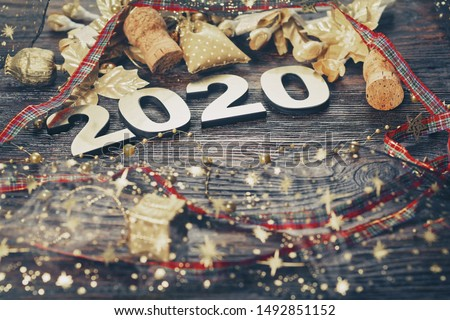 Happy New Year 2020. Symbol from number 2020 on wooden background #1492851152