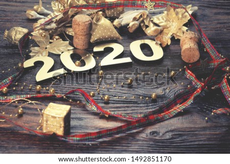 Happy New Year 2020. Symbol from number 2020 on wooden background #1492851170