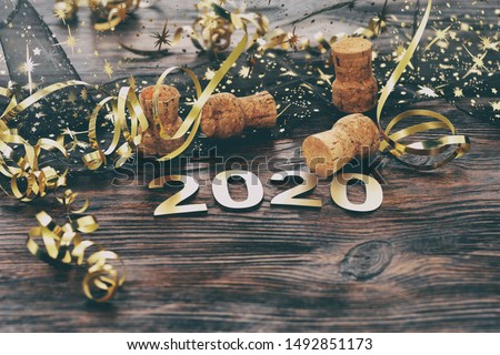 Happy New Year 2020. Symbol from number 2020 on wooden background Royalty-Free Stock Photo #1492851173