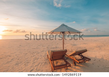 Relaxing sunset beach, summer vacation and holiday concept. Beach sunset view loungers and umbrella. Luxury travel landscape, exotic nature background. Paradise island view #1492869119