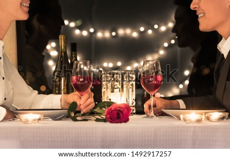 Man and woman enjoying a romantic candlelight dinner together.  #1492917257