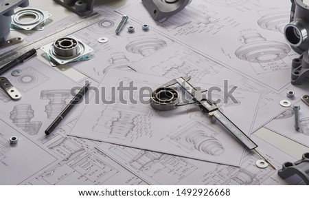 Engineer technician designing drawings mechanical parts engineering Engine
