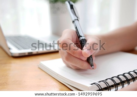 Business woman Manager checking and signing applicant filling documents reports papers company application form or registering claim on desk office. #1492959695