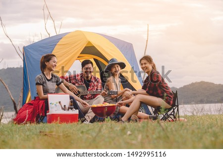 Group of Friends Asian Camp Forest Adventure Travel Remote Relax Concept, mountain view. Dinner party, Camping barbecue and drink beer. #1492995116