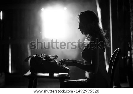 Silhouette of a beautiful girl in a dress on the background of a window in an old house #1492995320