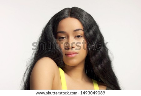 beauty mixed race african american model in studio portraits with long hair wig natural makeup Royalty-Free Stock Photo #1493049089