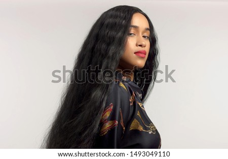 gorgeous mixed race model in studido shoot with long wavy wig on Royalty-Free Stock Photo #1493049110