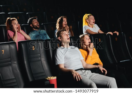 Young scared excited couple screaming at the cinema . close up side view photo.feeling and emotion #1493077919