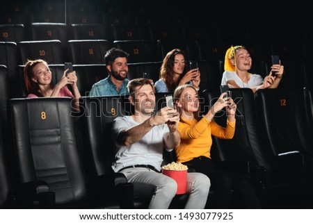 joyful young people taking a photo while watching movie Concept of fun and movie time. #1493077925