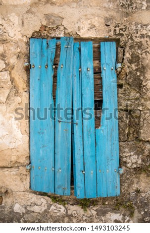 Old cracked blue wooden window in a stone house. Les Baux-de-Provence, Provence, France #1493103245