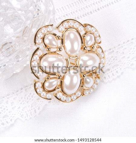 Vintage Monet brooch with inserts of white artificial pearls #1493128544