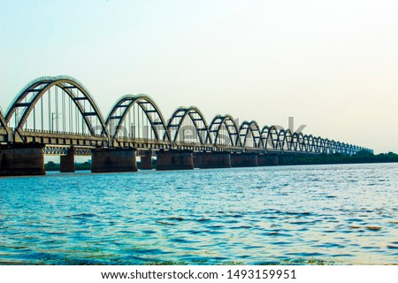 "The ""GODAVARI Arch Bridge"" is a bowstring-girder bridge that spans the Godavari River in Andhra Pradesh, India. The bridge is one of the longest span pre stressed concrete arch bridges in Asia #1493159951"