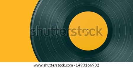 Vinyl record on a colored background. Old vintage vinyl record isolated #1493166932