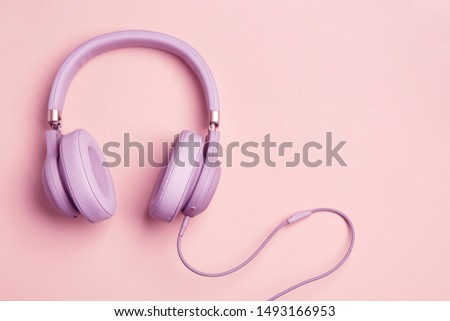 Colored headphones on a colored vintage background. Music concept with copyspace. Colored headphones isolated #1493166953