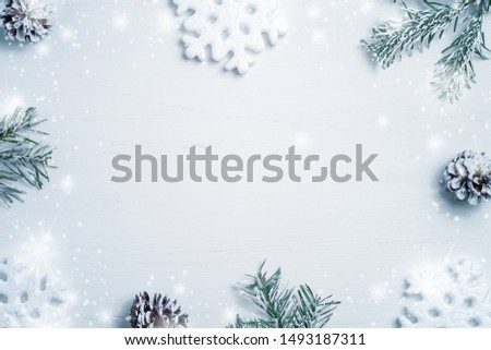 Bright Christmas composition, blank for design - snowflakes, Christmas tree branches and cones, copy space, place for text, flatlay