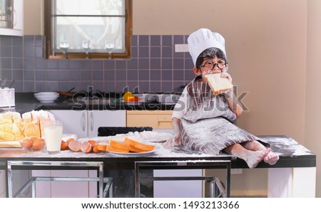 Cute child learning cooking make room Messy room Royalty-Free Stock Photo #1493213366