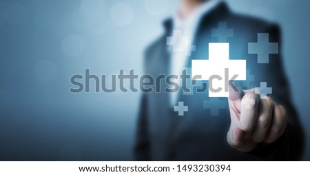 Businessman hand touching plus sign icon means to offer positive thing (like benefits, personal development, social network) #1493230394