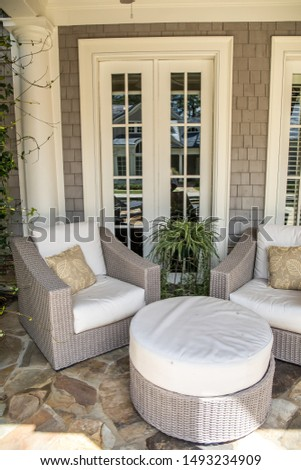 outdoor patio porch of traditional upgraded custom home with seating for entertaining and dining #1493234909