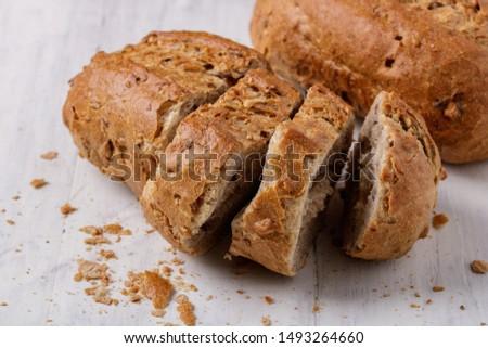 chopped whole grain bun on a table #1493264660