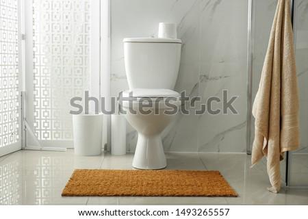 Toilet bowl near shower stall in modern bathroom interior #1493265557